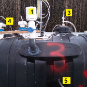 Picture of 4 digesters with sprayer tanks