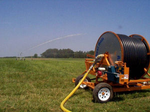 Irrigation of wastewater by hard hose traveling gun