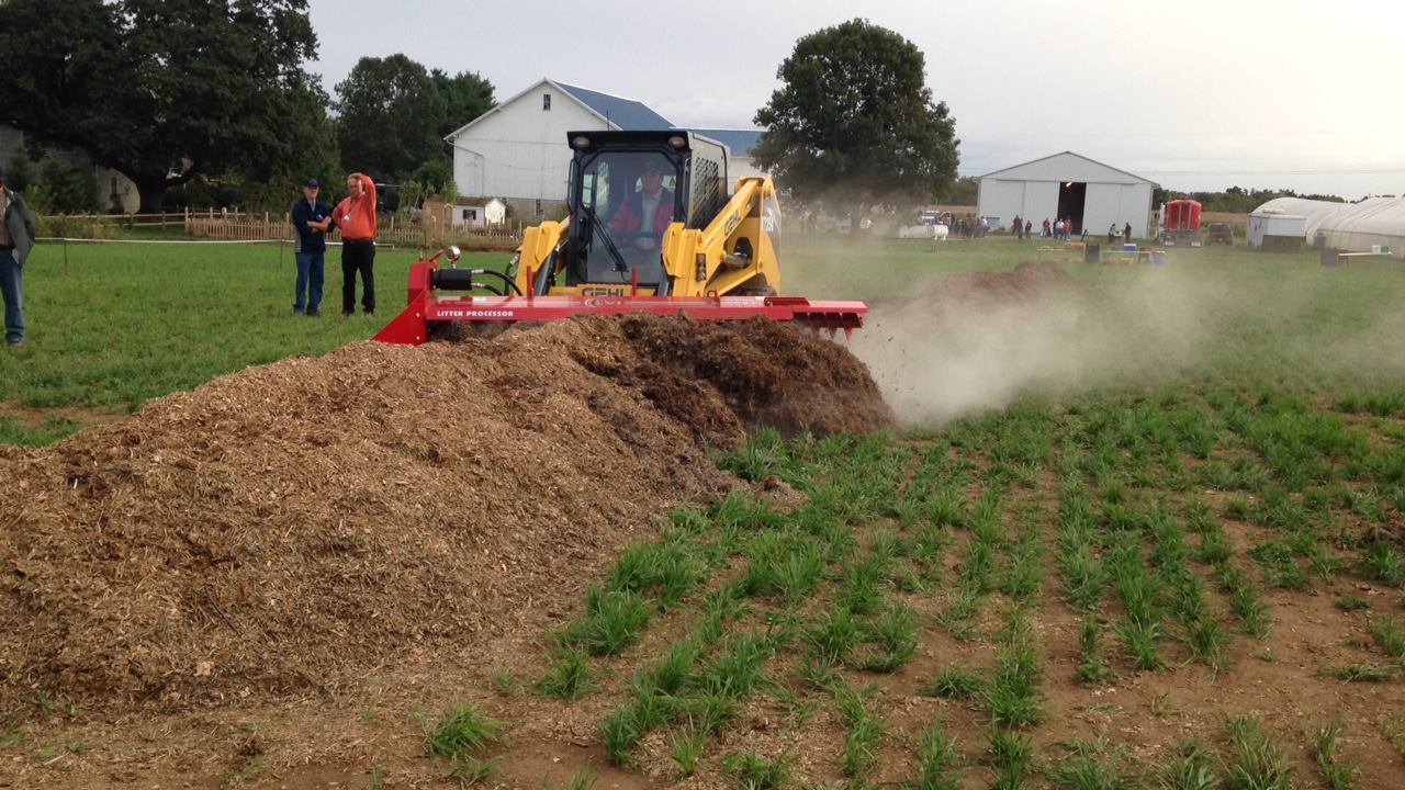 Demo with tractor covering mortality composting pile