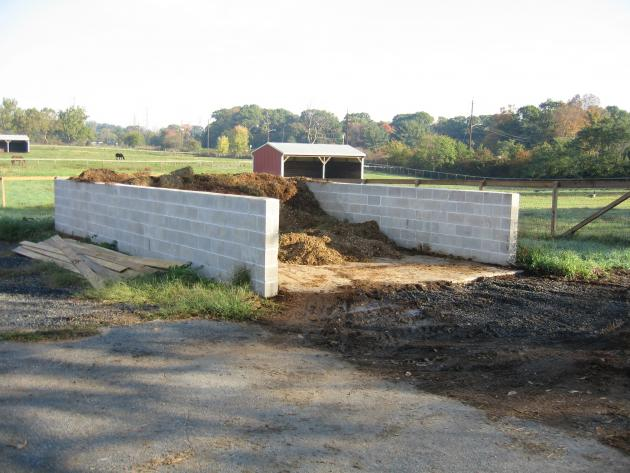 a concrete manure storage structure on a small horse farm
